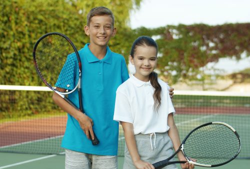 Portrait,Of,Caucasian,Cute,Cheerful,Small,Kids,Holding,Rackets,And
