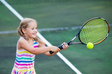 Child,Playing,Tennis,On,Outdoor,Court.,Little,Girl,With,Tennis